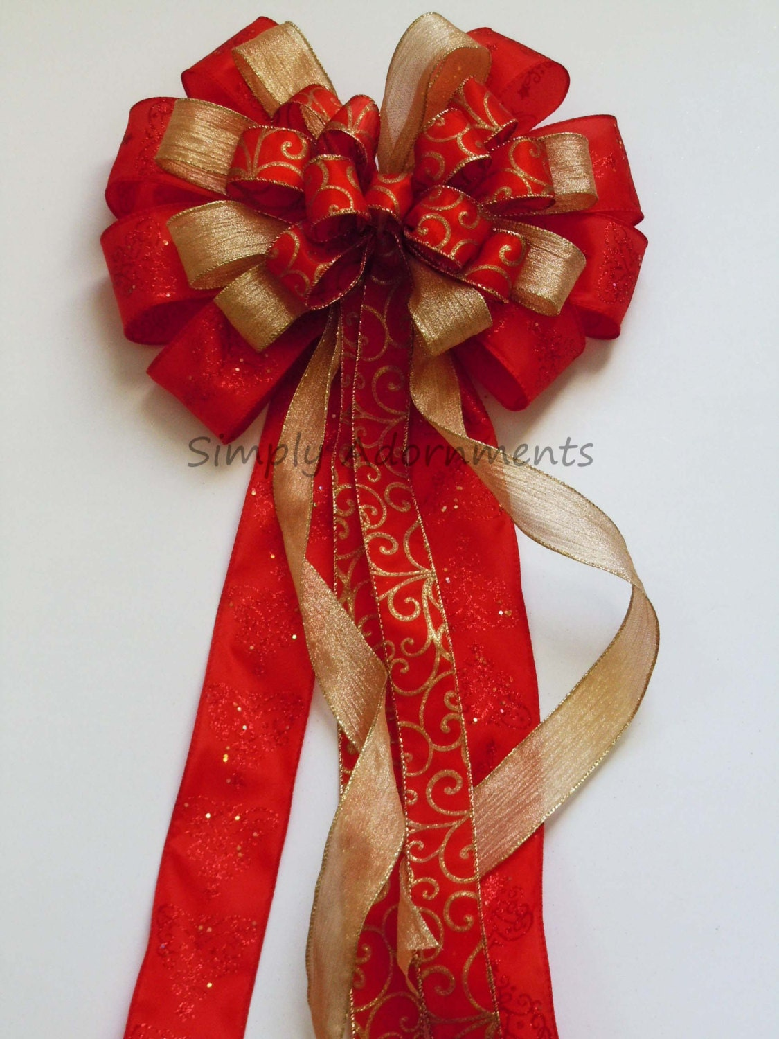 red gold christmas bow red and gold christmas tree topper bow. Black Bedroom Furniture Sets. Home Design Ideas