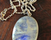 Iridescent moonstone pendant necklace. Setting is sterling silver.  Stirling silver chain and closure.  FREE SHIPPING.