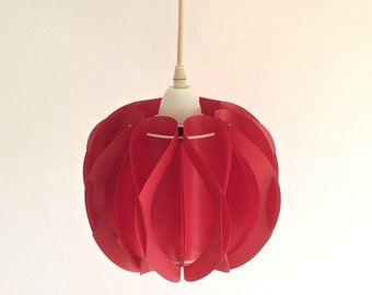 Dark red folded plastic or bent plastic pendant light or hanging lamp. For ambient lighting. Vintage Scandinavian design.