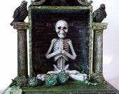 6 a.m. Yoga Class. Skeleton shrine box mixed media assemblage