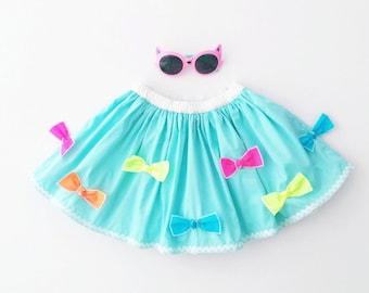 Girls cotton ruffle skirt. Little girls blue & white skirt. Girls frilly skirt with colorful bows.