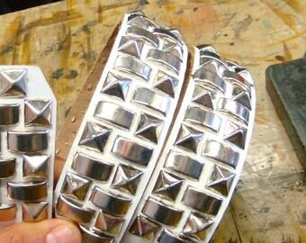 Silver pyramid/flat rivet studded white leather belt