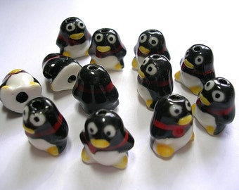 10 Lampwork Pinguen Beads Black and White Porcelain Birds with Red Scarves 16X15X12MM with a 2mm Hole.  Very Cute Penguin People!