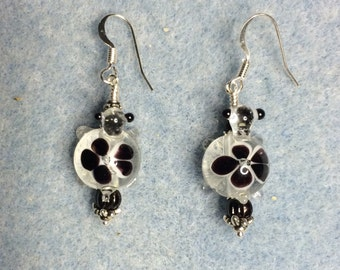 Clear and black lampwork turtle bead dangle earrings adorned with black Czech glass beads.