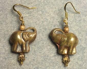 Tan Czech glass elephant bead dangle earrings adorned with tan Czech glass beads.