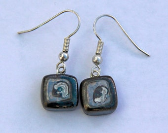 Square earrings with lustres.