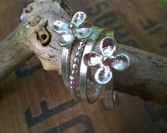 Silver and gold flower stack rings