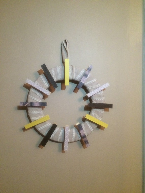 Brown wood and yellow neutral clothespin wreath