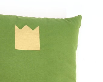 Green pillow with crown