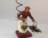 Petites Choses monkey with baskets, modeled after 1920s Viennese bronze original