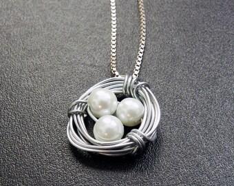 Handmade White Bead Bird Nest Pendant