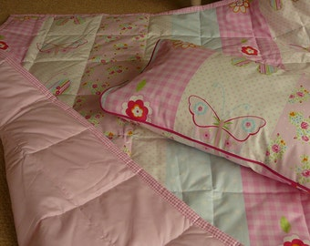 cot bed quilt and pillow or play mat