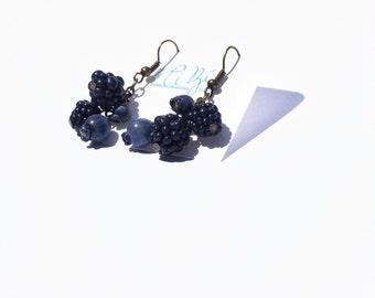 Dangling blackberries and blueberries