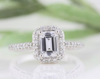 Forever One Emerald Moissanite Engagement Ring with Diamond Halo Fancy Gallery, 7 x 5 mm Emerald Cut Moissanite and Diamond Ring