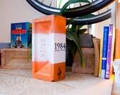 Painted Brick Book 1984 on Orange and White Brick