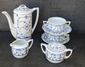 7 piece vintage coffee service: Coffee pot,  2 cups, 2 saucers, milk jug and sugar pot. Jaeger Eisenberg, blue and white china.