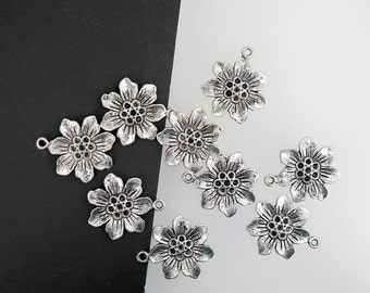 Silver flower charms. Antiqued flower charms. Zipper pull. 10 pieces.