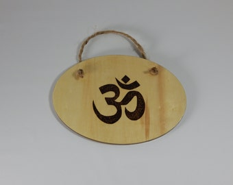 Handcrafted wood burned plaque with Om.