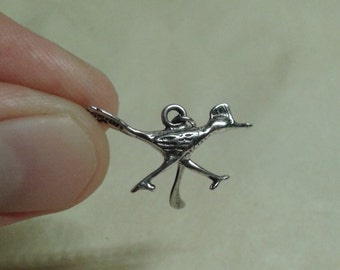 A sterling silver Arizona roadrunner charm