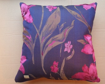 Eye catching outdoor or indoor pillow covers in a gorgeous purple and cerise water resistant fabric
