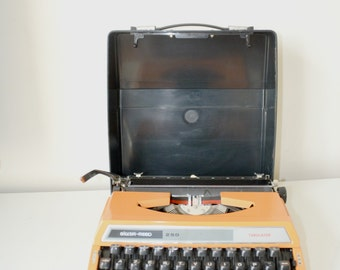"MACHINE to write portable ""Silver Reed 250"", orange, typewriter,"
