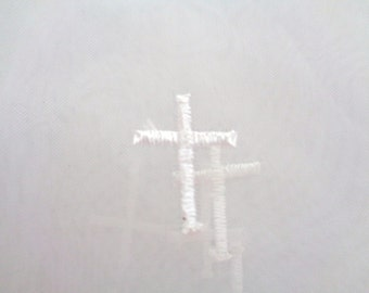1 yard white organza with embroidered cross motif