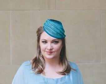 Turquoise sinamay ripple hat.