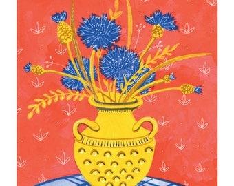 Cornflowers bouquet in ceramic vase