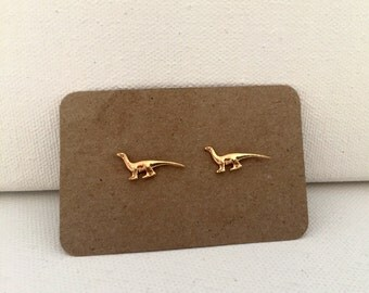 Golden dinosaur earrings
