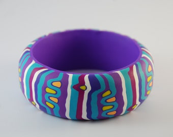 Bracelet of clay polymer points and stripes purple with turquoise
