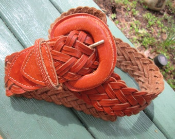 Burnished brown all leather woven belt. Leather buckle.Made in Uraquay. Size ML up to 39""