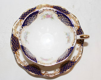 Royal Albert: Isabella Teacup and Saucer Royal Blue,Gold Scrolls, Pink Flowers Excellent