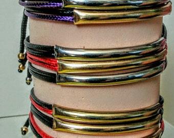 A TRIPLE STRAND Bracelet.