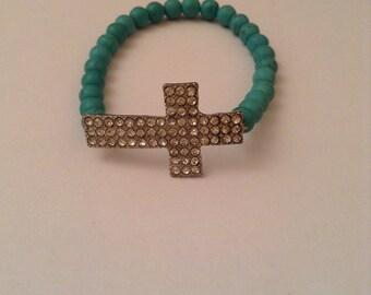 Cross turquoise beaded bracelet.
