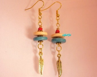 Earrings with turquoise and cream ceramic beads