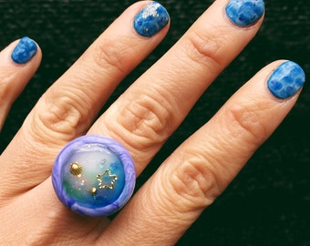 Handmade polymerclay ring encapsulated with resin, charms and gems