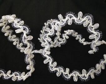 White Nylon Horsehair with wire core, flexible, easy to shape, vintage, 3/4 inch wide, offering it in 16 yard lots, 5 lots available.