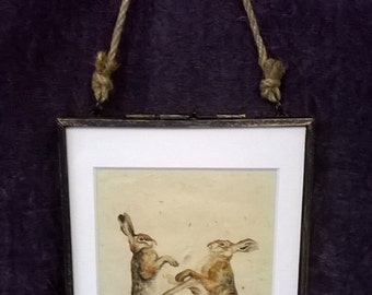 Hares boxing, in  glass hanging picture frame,  printed on Handmade paper