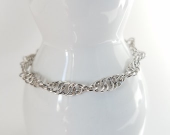 Spiral weave rhodium color metal hand made chain maille bracelet