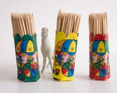 Three vintage cardboard toothpick holders