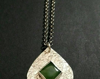 Sterling silver, texturized, stone necklace.