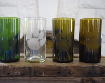 Set of four upcycled wine bottle glasses with custom design