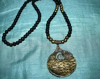 Natural Lava rock beads with bronze swirl pendant