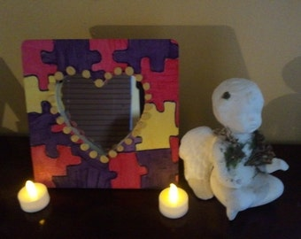 Puzzle patterened frame