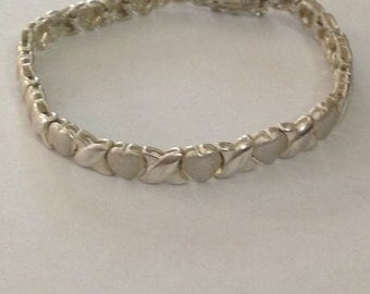 Beautiful sterling silver X's and Hearts bracelet size 7