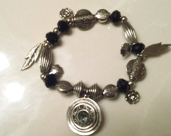 Tibetan Silvertone Feathers and Flowers Charms Bracelet with Black and Silver Beads