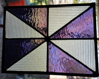 Purple iridescent and clear textured leaded stained glass panel.