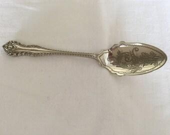 A decorative EPNS jam spoon