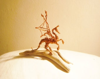 Copper wire dragon on Driftwood
