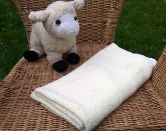 Cream hand knitted baby blanket